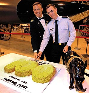 CO No. 1 Squadron WGCDR Steve and the squadron's youngest member, AC Rory Davis, cut the cake at the dining-in night to celebrate the squadron's centenary. Photo by Corporal Ben Dempster