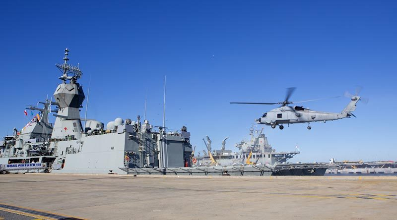 HMAS Perth receives her MH-60R 'Romeo' helicopter before departure on operation Manitou.