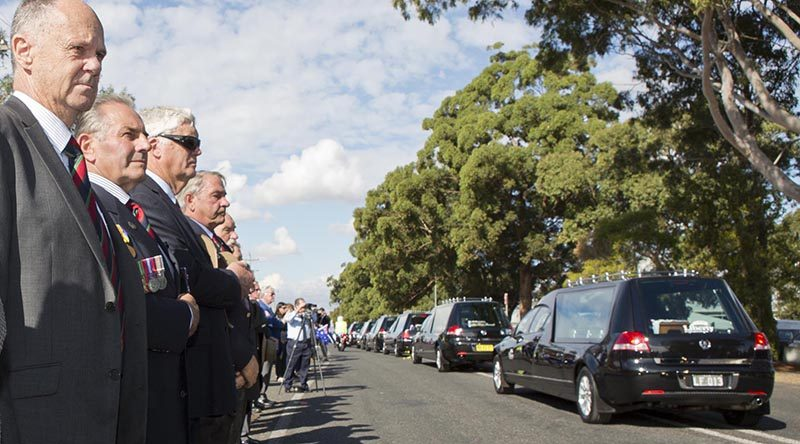 Hearses carrying the remains of 33 Australian service personnel and dependants leave RAAF Base Richmond after a repatriation ceremony at the base to welcome them home from cemeteries in Malaysia and Singapore. Photo by Corporal David Gibbs