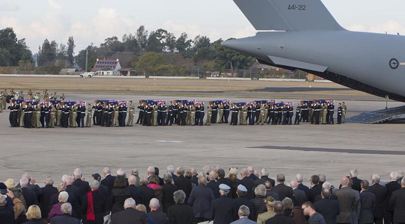 Australian Defence Force personnel from Australia's Federation Guard carry the coffins of the 33 Australian service personnel and dependants from a Royal Australian Air Force C-17A Globemaster aircraft during the repatriation ceremony at RAAF Base Richmond in Sydney on Thursday, 02 June 2016.
