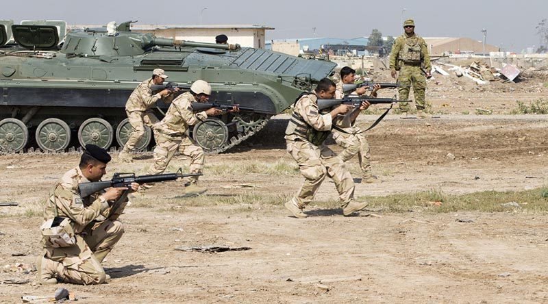 Iraqi Army soldiers conduct tactics training while Australian Army soldier Warrant Officer Class 2 Tomasi Navusolo observes, at the Taji Military Complex, Iraq. Photo by Corporal Jake Sims