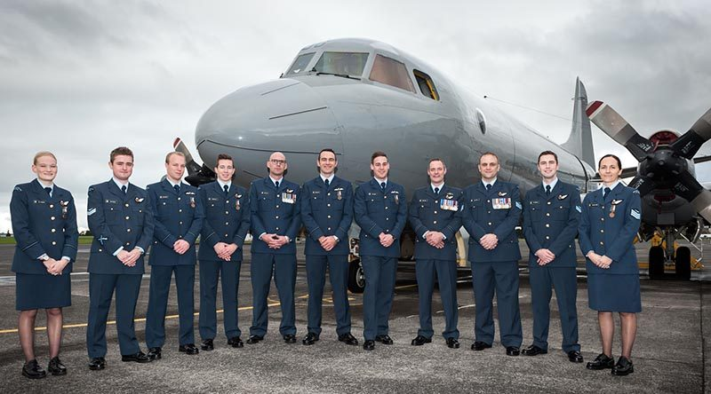 No. 5 Squadron 15/01 Orion Conversion Course graduates pose in front of the P-3K2 Orion on which they participated in a real-life search and rescue operation during their training.