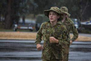 Australian Air Force Cadet Sam Venturi gets a taste of battle PT in the Canberra cold and rain at the Australian Defence Force Academy. *** Local Caption *** Australian Air Force Cadets (AAFC) from No 2 Wing commemorated the 75th anniversary of the AAFCs with a tour of military establishments and museums/memorials in Williamtown, Canberra and Sydney. The Australian Air Force Cadets (AAFC) is a youth oriented organisation that is administered and actively supported by the Royal Australian Air Force. The AAFC teaches you valuable life skills and will help you develop qualities including leadership, self reliance, confidence, teamwork and communication. Their fundamental aim is to foster qualities that will enable cadets to become responsible young adults, who will make a valuable contribution to the community. Please note the following distinction: Australian Air Force Cadets (AAFC), along with Australian Navy Cadets and Australian Army Cadets are members of the Australian Defence Force (ADF) Cadets. ADF Cadets are participants in the youth development program conducted by the three services in cooperation with the community but they are not members of the ADF. Officer Cadets (Air Force) and Staff Cadets (Army) are trainee officers undertaking instruction at the Australian Defence Force Academy or the Air Force Officers' Training School or Royal Military College Duntroon, The terms 'ADF Cadets', 'Officer Cadets' and 'Staff Cadets' are not interchangeable. Trainee naval officers are not cadets; they are commissioned officers with the rank of Midshipman.