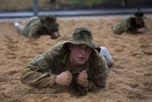 Australian Air Force Cadet Josh Hillwebber leopard crawls during battle PT in the Canberra cold and rain at the Australian Defence Force Academy. *** Local Caption *** Australian Air Force Cadets (AAFC) from No 2 Wing commemorated the 75th anniversary of the AAFCs with a tour of military establishments and museums/memorials in Williamtown, Canberra and Sydney. The Australian Air Force Cadets (AAFC) is a youth oriented organisation that is administered and actively supported by the Royal Australian Air Force. The AAFC teaches you valuable life skills and will help you develop qualities including leadership, self reliance, confidence, teamwork and communication. Their fundamental aim is to foster qualities that will enable cadets to become responsible young adults, who will make a valuable contribution to the community. Please note the following distinction: Australian Air Force Cadets (AAFC), along with Australian Navy Cadets and Australian Army Cadets are members of the Australian Defence Force (ADF) Cadets. ADF Cadets are participants in the youth development program conducted by the three services in cooperation with the community but they are not members of the ADF. Officer Cadets (Air Force) and Staff Cadets (Army) are trainee officers undertaking instruction at the Australian Defence Force Academy or the Air Force Officers' Training School or Royal Military College Duntroon, The terms 'ADF Cadets', 'Officer Cadets' and 'Staff Cadets' are not interchangeable. Trainee naval officers are not cadets; they are commissioned officers with the rank of Midshipman.
