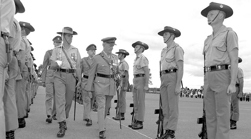 FILE PHOTO (1983): Soldiers of 3RAR parade at Holsworthy parade for the 32nd anniversary of The Battle of Kapyong. They are inspected by the Colonel Commandant of The Royal Australian Regiment , General Sir Arthur Macdonald, escorted by Lieutenant Colonel Jim Connolly, CO 3RAR. Also on parade were 120 Scots Guards, in Australia for training with 3RAR. Australian Army file photo by Private Talon.