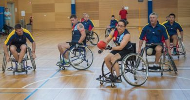 File photo – Wheelchair Aussie Rules player Corporal Sarah Mayadas takes a shot at goal during the first officially organised game of Wheelchair Australian Rules at RAAF Base Edinburgh in 2015. Photo by Corporal Nunu Campos
