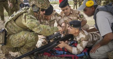 Australian Army soldier Corporal Stefan Pitruzzello makes a scope adjustment on a variant of the Steyr HS .50-calibre rifle while training Iraqi Army personnel in Iraq. Photo by Leading Seaman Jake Badior