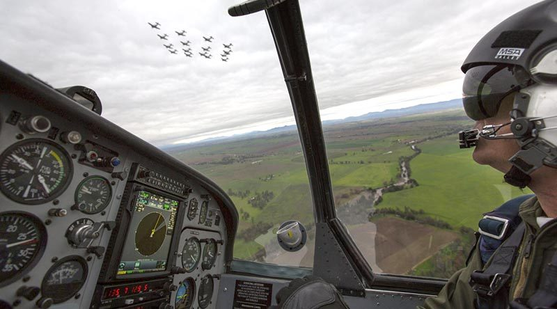 Lieutenant Commander Andrew Kidd, a qualified flying instructor at the ADF Basic Flying Training School, follows a formation of 16 Pacific Aerospace CT-4B Airtrainers flying over Tamworth. Photo by Corporal Ollie Carter