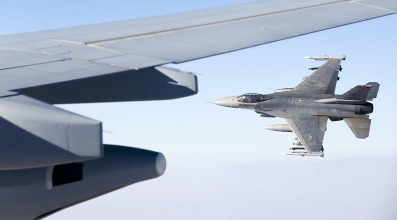 "A 480th Fighter Squadron ""Warhawks"" F-16C flies alongside after refuelling from a KC-30A Multi-Role Tanker Transport air-to-air refuelling aircraft over the Middle East Region. Photo by Corporal Nicci Freeman"