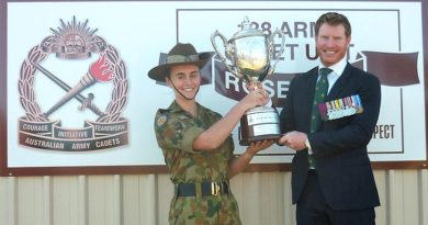 Corporal Daniel Keighran VC presents the Daniel Keighran VC Trainee of Merit Trophy to Cadet Corporal Brooklyn Davis