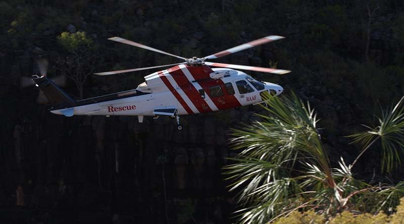 A CHC Helicopter SAR helicopter performs a training flight through a gorge in the Katherine region. CHC Helicopters (Australia) provides a search-and-rescue response to all ejection-seat fitted aircraft serving in the RAAF – and now also for major Army exercises. The helicopters are based at RAAF Bases Tindal, Pearce, East Sale, Williamtown and Amberley. Photo by Corporal Terry Hartin.