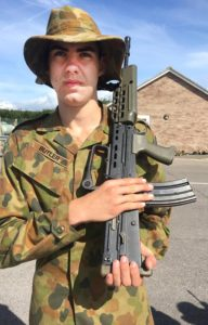 Cadet Lance Corporal Jayden Butler gets a drill orientation lesson with the standard-issue rifle of the UK Defence Forces.