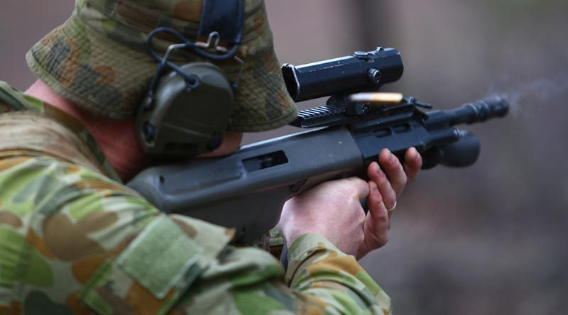 An Australian soldier engages targets at Puckapunyal during Exercise Southern Jackaroo 2014.