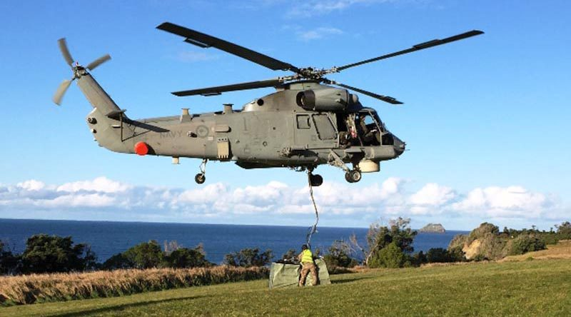 The Seasprite helicopter drops off one of its underslung loads on Raoul Island. RNZDF photo