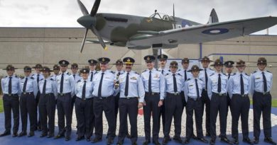 Chief of Air Force Air Marshal Leo Davies poses with RAAF Cadets after unveiling a Spitfire MK VIII LF replica, A58-492 at the RAAF Museum at Point Cook, Victoria. Photo by Flight Lieutenant Robert Palmer