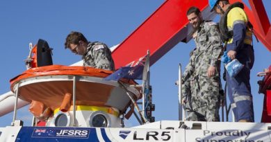 Simulated casualty volunteers enter the LR5 Sub Rescue Vessel to be transferred to HMAS Dechaineux during Ex Black Carillon 2016. Photo by Leading Seaman Bradley Darvill.