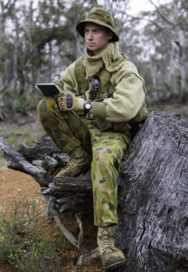 Australian Army Cadets trainee Cadet Corporal David Baker, from 504th Army Cadet Unit, writes his orders in his field notebook during the annual field exercise in Bindoon training area, north-east of Perth, on 1 October 2016.