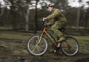 An Australian Army Cadets trainee competes in the mountain bike time trial during the annual field exercise in Bindoon training area, north-east of Perth, on 1 October 2016.