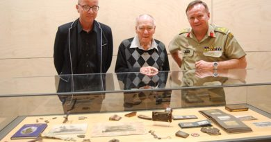 Jack Moore (centre) with Sebastian Spencer and Brigadier Wayne Budd behind the collection Mr Moore donated to the Australian Army Museum of Military Engineering.