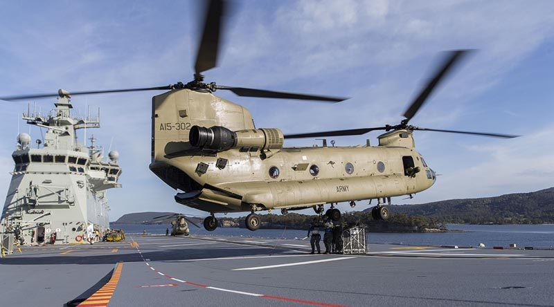 An Australian Army CH47F Chinook hovers over HMAS Adelaide's flight deck during first-of-class flight trials. Photo by Petty Officer Paul McCallum.