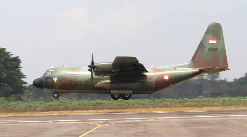 A TNI-AU C-130B Hercules conducts a low-level pass of the runway during Exercise Rajawali Ausindo 12. Photo by Eamon Hamilton.
