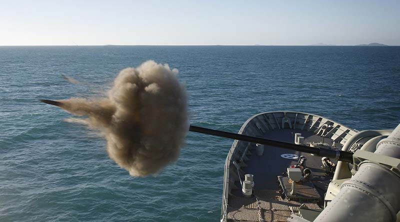 HMAS Perth fires her 5-inch gun during the closing stages of exercise Talisman Saber 2013. Photo by Leading Seaman Yuri Ramsey