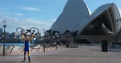 Laurie 'Truck' Sams celebrates reaching the Sydney Opera House at the end of an epic 10,200km bike ride – The Long Ride Home – from Hanoi, Vietnam. Photo by CONTACT 'roving reporter' Sue Monckton.