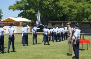 No 604 Squadron Cadets conduct a march past and 'Eyes Right', and receive salutes from the Reviewing Officer, Major Jim O'Hanlon, Second in Command Adelaide University Regiment, and Commanding Officer of 604 Squadron, Flying Officer (AAFC) John Bennett.