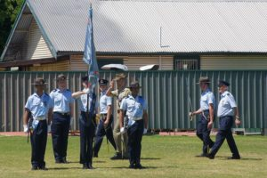 Parade Commander Cadet Under Officer Aaron Musk and Reviewing Officer Major Jim O'Hanlon, Second in Command Adelaide Universities Regiment, salute as they pass the Banner of No 6 Wing AAFC.