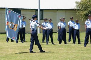 Banner Bearer, Cadet Under Officer Hayden Skiparis, 'shows' the Banner of No 6 Wing AAFC.