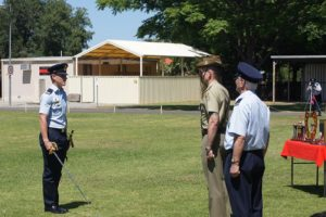 Parade Commander, Cadet Under Officer Aaron Musk, salutes the Reviewing Officer, Major Jim O'Hanlon, Second in Command of the Adelaide Universities Regiment and invites him to inspect the Squadron.