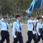 609 Squadron Banner Bearer Cadet Sergeant Alexander Burrow, with Banner Escorts Leading Cadets Charlie Morman and Lucille Rattigan. The Banner Warrant Officer (saluting) is Cadet Sergeant Aaron Taliangis.