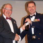 Guest speaker Group Captain Richard Trotman-Dickenson, Officer Commanding Information Warfare Wing at RAAF Base Edinburgh receives a token of appreciation from emcee Pilot Officer (AAFC) Paul Rosenzweig.