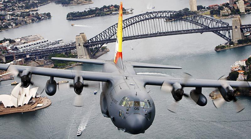 Former No. 37 Squadron C-130H Hercules A97-005 flies over Sydney Harbour on 19 November 2012, shortly before retirement from the RAAF and an official handover to Indonesian pilots at RAAF Base Richmond. The plane was destroyed when it crashed into a mountain in Papua on 18 December 2016. Photo by Corporal David Said.