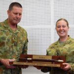 RSM-A WO Don Spinks presents CUO Ashlie Wilkie, 22 Australian Army Cadet Battalion , with the RSM-A National Drill competition pace stick.