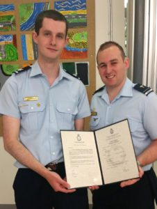 Cadet Sergeant Thomas Stagbouer receives his Certificate of Service from Flying Officer (AAFC) Simon Blair.
