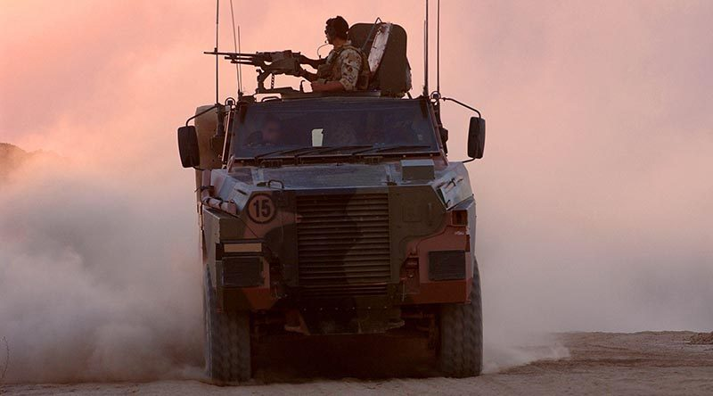 Australian soldiers on patrol in Afghanistan aboard a Bushmaster. Photo by Corporal Bernard Pearson.