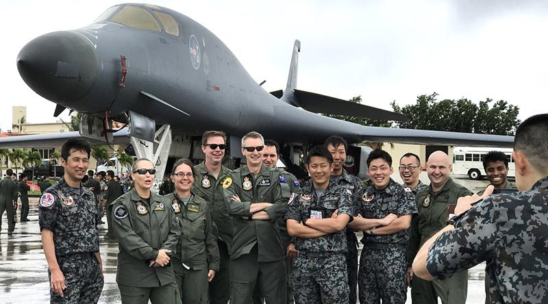Participants of Exercise Cope North 17 from Japan and Australia pose for a photograph in front of a B-1B Lancer at Andersen Air Force Base. Photo by Sergeant Amanda Campbell.