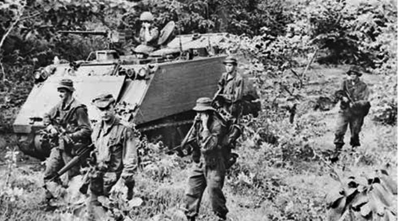 One of thousands of photos taken by Billy Cunneen in Vietnam – 1966, Australian APCs of 1 APC Sqn and dismounted soldiers pursue retreating Viet Cong troops in Phuoc Tuy Province. Click to enlarge.
