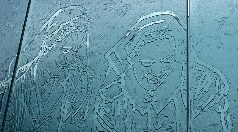 A glass-panel depiction of Australian Army nurses in WWII –part of a magnificent national memorial to Service Nurses on Anzac Parade, Canberra, dedicated in 1999. Photo by Brian Hartigan.