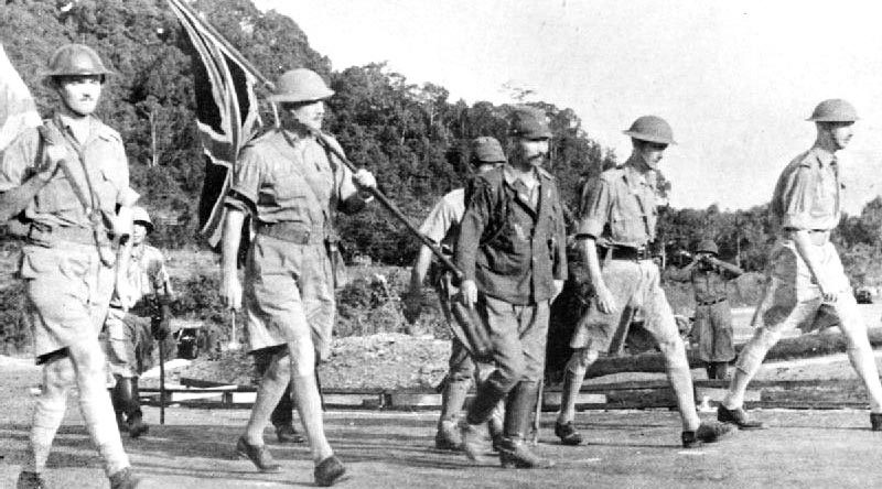 Lieutenant-General Arthur Ernest Percival, led by a Japanese officer, walks under a flag of truce to negotiate the capitulation of Allied forces in Singapore, on 15 February 1942. It was the largest surrender of British-led forces in history.