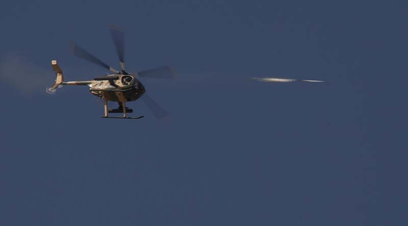 An Afghanistan Air Force Cayuse Warrior helicopter conducts an air-to-ground rocket attack during Afghanistan National Army and Air Force Terminal Air Controllers practical assessment of their training. Photo by Sergeant Rob Hack.