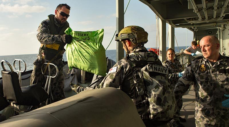 HMAS Arunta personnel account for illegal narcotics they seized in the Middle East. Photo by Able Seaman Steven Thompson.