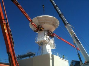 Hoisting and locking the parabolic antenna into place on the joint Australian/United States C-Band Space Surveillance Radar at Exmouth, Western Australia (file photo 2014).