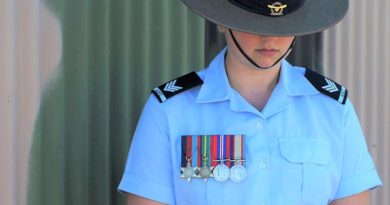 Cadet Sergeant Casey Dibben (No 6 Wing AAFC) wears the medals of her maternal great-grandfather Private Geoffrey Whiteman (6th Australian Division Workshops AIF).