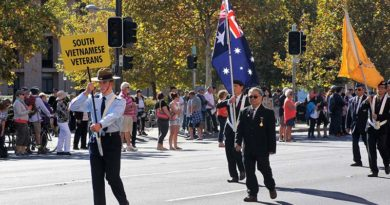 Cadet Flight-Sergeant Jake Dippy prepares to lead the contingent of South Vietnamese veterans in the 2016 Anzac Day March in Adelaide.