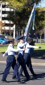 Banner Party of No 6 (City of Adelaide) Wing, AAFC lead the Air Force Cadets contingent in the 2016 Anzac Day March in Adelaide, left to right: Cadet Sergeant Bianca Poppy (now Cadet Under Officer), Cadet Under Officer Andrew Lusher and Cadet Sergeant Kelsey Wurfel (now Cadet Warrant Officer).