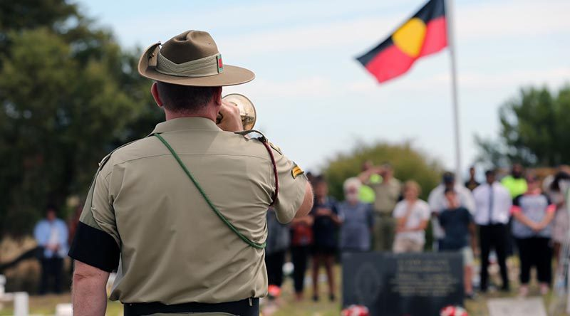 Australian Army Band Adelaide Bugler, Corporal Andrew Barnett, plays the Last Post for World War One soldier, Private Miller Mack, during his reinterment service in Raukkan, South Australia on 24 March 2017. Photo by Sergeant W Guthrie.