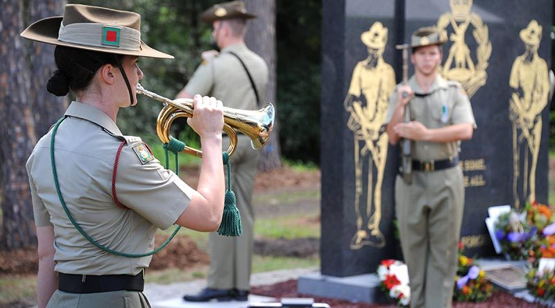 Musician Acacia Cuthbertson, from the Australian Army Band Brisbane, plays the last post at the blessing and dedication of The Royal Australian Regiment Memorial at Ferguson Park, Enoggera on 24 March 2017. Photo by Captain Anna-Lise Rosendahl.