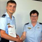 Leading Cadet Levi Schubert receives his Duke of Edinburgh's International Award Bronze Award badge and certificate from the 6 Wing DEA Coordinator Flight Lieutenant (AAFC) Rae Nicholas.